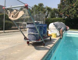 Bruce Deifel repairs grout